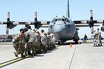 374th Maintenance Squadron pull a C-130 Hercules (26301939800).jpg