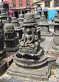 4 Buddha and Shiva Linga Vajrayana Buddhism.jpg