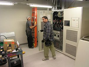 Uninterruptible power supply - A large datacenter-scale UPS being installed by electricians