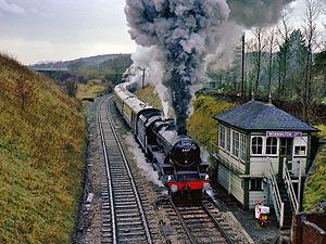 Wennington railway station - Preserved Black Five 4-6-0 locomotive 5407 passes Wennington Junction signal box in 1982.