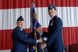 Change of command - Col. Jim Jones (right) accepts the 55th Wing's guidon from Eighth Air Force Commander Lt. Gen. Robert J. Elder, Jr. (left) during a wing change of command ceremony at Offutt Air Force Base, Nebraska, USA.