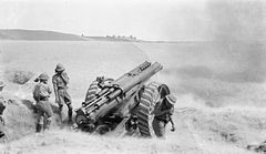 60 pounder gun firing in Mesopotamia WWI IWM Q 24285.jpg