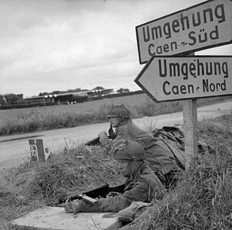 5th Parachute Brigade (United Kingdom) - Defensive position near Ranville 7 June, with Horsa gliders in the background (The signs, in German, say Bypass)