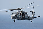 A U.S. Navy MH-60S Seahawk helicopter assigned to Helicopter Sea Combat Squadron (HSC) 28 conducts air operations while attached to the amphibious assault ship USS Kearsarge (LHD 3) May 2, 2013, in the Gulf 130502-N-SB587-294.jpg