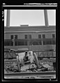 A cannon that saw duty in World War I stands in the yard of a Chicago steel mill 8b07774v.jpg