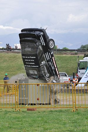 A car thrown into garbage container.jpg