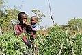 A farmer with a child.jpg