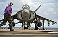 A flight deck crewman refuels an AV-8B Harrier jet aircraft on the flight deck of the amphibious assault ship USS Bonhomme Richard (LHD 6) during flight operations in the Philippine Sea 120920-N-KB563-091.jpg