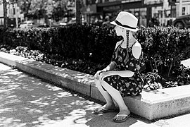 A girl resting in shade during the summer heat.jpg