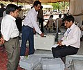 A polling official collecting the Electronic Voting Machine (EVM) and other necessary belongings for use in the General Elections-2014, at the distribution centre, in Haldwani, Uttarakhand on May 06, 2014.jpg