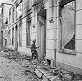 A soldier of 6th King's Own Scottish Borderers, 15th (Scottish) Division, searches wrecked buildings in Blerick, a suburb of Venlo in Holland, 5 December 1944. B12527.jpg