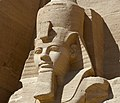 Abu Simbel temple left guard angle view.jpg
