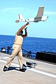 Adm. Sinclair Harris launches a Puma UAV. (8696783142).jpg