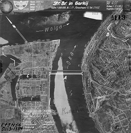 "Aerial photography of Gorky with indication of targets for bombing. Strategic Center ""Kremlin"": Translation of labels on the map A -- Reinforced (pontoon) bridge (5 supports, distance between supports ~ 120m, length 740m, width 21m); B - The Kremlin (1 - House of Soviets, 2 - Military school, 3 - Arsenal); S - The Fair (1 - The Main Fair building, 2 - Exchange); The mill is surrounded by a white solid line. Aerial photography of Gorky.jpg"