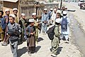 Afghan children are released from school as U.S. Soldiers with Charlie Company, 3rd Battalion, 187 Infantry Regiment, 101st Airborne Division, from Forward Operating Base Rushmore, pass by while on a patrol 100821-A-OD503-048.jpg
