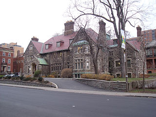 This former mansion in the Tudor revival style was completed in 1926 and retains most of its original interiors, including ornate dark wood panelling with a decorative frieze.