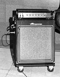 A 1950s era amplifier unit sitting on top of a bass speaker cabinet.