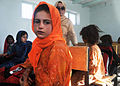 An Afghan girl and student of the newly opened Shar-e Sara Girls School waits for an eye examination from a coalition forces' ophthalmologist in Zabul province, Afghanistan, Sept 110913-N-AT856-030.jpg