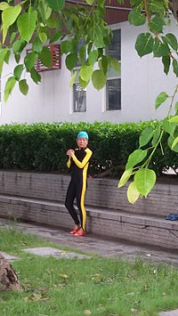 An old woman wearing body-skin swimsuit in SaiGaau Swimming Ground 1.jpg