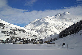 Andermatt looking east towards the Oberalp Pass with cable car (to Gemsstock) bottom station in front and Rossbodenstock (2836m) in the back (8 Feb 2003)