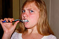 Annoyed Girl Brushing Teeth.jpg