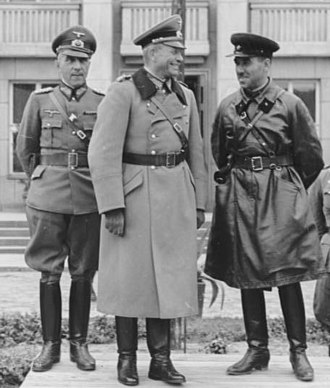 Soviet occupation of Latvia in 1940 - A joint parade of Wehrmacht and Red Army in Brest at the end of the invasion of Poland. On the tribune are Major General Heinz Guderian (centre) and Brigadier Semyon Krivoshein (right)