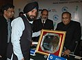 Arvinder Singh Lovely receiving the National Award for Excellence in Urban Transport from the Union Minister of Urban Development, Shri S. Jaipal Reddy, at the Valedictory Session of 2nd Urban Mobility India Conference-2009.jpg