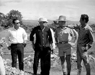 Military history of Australia during the Vietnam War - Members of an Australian civic action team confer with Vietnamese village officials on plans for local improvements
