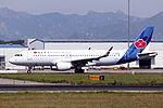 B-9956 - Qingdao Airlines - Airbus A320-214(WL) - TAO (14419699437).jpg