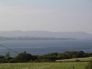 Whiddy Island - Whiddy Island oil terminal, seen from the north shore of Bantry Bay in 2003