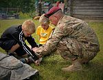Basic medical training provided for Latvian survival campers 150717-A-ZZ359-064.jpg