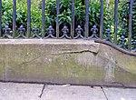 Benchmark on wall of St Luke's garden, Liverpool.jpg