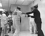 Bill Anders shakes hands with Buzz and wishes him well as he and the others enter the elevator in the MSOB on launch day.jpg