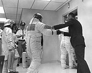 Bill Anders shakes hands with Buzz and wishes him well as he and the others enter the elevator in the MSOB on launch day
