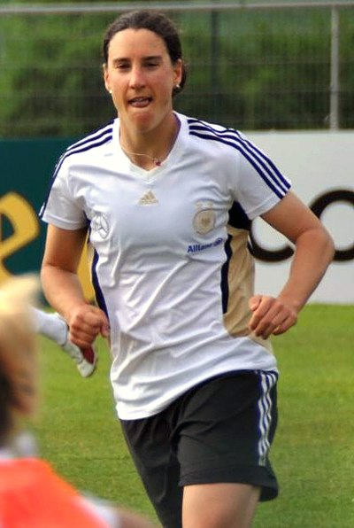Birgit Prinz is tied for the second most goals in all tournaments, and won the title twice representing Germany. Birgit Prinz.jpg