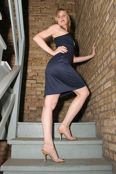 File:Blonde Woman Poses on Stairs.jpg
