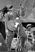 Bob Marley onstage with a guitar