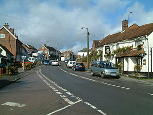 Bovingdon High Street looking north with The Bell public house opposite