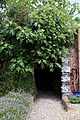 Brick wall flint arch in Walled Garden of Goodnestone Park Kent England.jpg