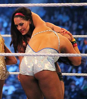 Suplex - Brie Bella setting up a snap suplex on Aksana at WrestleMania XXX