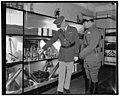 Bullets interest Cuban Dictator. Washington, D.C., Nov. 12. Shown through the World War Museum at Arlington amphitheater today, Col. Fulgencio Batista, right, Cuban Dictator, seemed LCCN2016874336.jpg