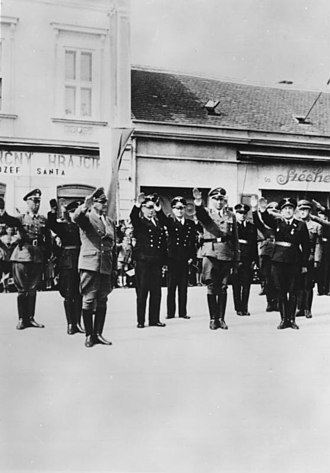 Hans Globke - Globke, Wilhelm Frick and Wilhelm Stuckart performing Nazi salute, 1941
