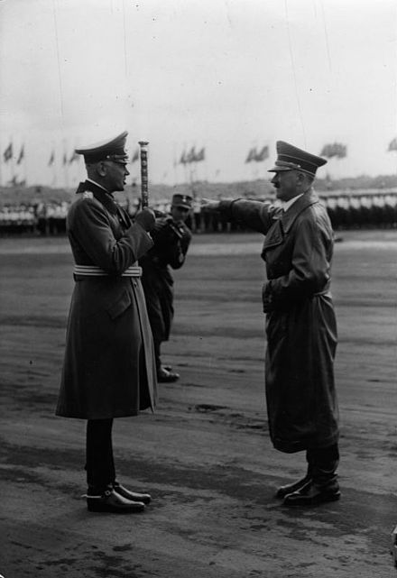 Werner von Blomberg (left) saluting Adolf Hitler (right) with a baton at the 1937 Nuremberg Rally. Bundesarchiv Bild 183-C13029, Nurnberg, Reichsparteitag, von Blomberg, Hitler.jpg