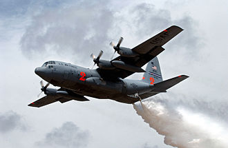 Modular Airborne FireFighting System - A MAFFS-equipped C-130 Hercules from the 302nd Airlift Wing makes a water drop over New Mexico during a training exercise, May 2007
