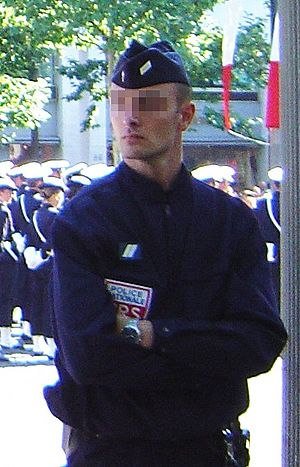 Side cap - A CRS in normal gear, standing by a Bastille Day parade