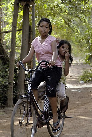 Youth in Cambodia - Cambodian girls on a bicycle