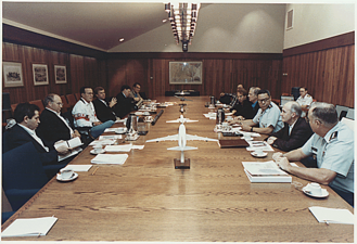 George H. W. Bush meets with his national security advisors in the Laurel Lodge conference room on August 4, 1990.