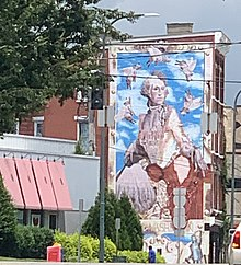 This photo is taken of a mural near downtown Cincinnati where the meat packing businesses were located. It shows a cow named Cincinnati Freedom who escaped from the slaughtehouse, and later lived out her life in a farm sanctuary in the state of New York.