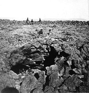 Modoc War - U.S. soldiers inspect Captain Jack's cave in the Lava Beds. 1873 Edward Muybridge photo