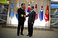 Chairman of the Joint Chiefs of Staff Navy Adm. Mike Mullen, left, greets South Korean Minister of National Defense Kim Kwan-jin in Seoul, South Korea 101208-N-TT977-090.jpg